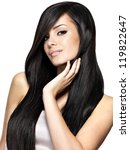 Small photo of Beautiful woman with long straight hair. Fashion model posing at studio.
