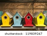 Four Colored Bird Feeders