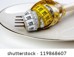 Fork with measuring tape as a symbol of disciplined dieting and weight reduction - stock photo