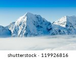 Winter mountains - ski slopes in Italian Alps - stock photo