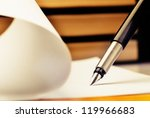 Stock photo close up of fountain pen and book 119966683