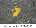 A Yellow Painted Footprint On ...