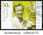 AUSTRALIA - CIRCA 2003: A Stamp printed in AUSTRALIA shows the portrait of a Rod Laver with Wimbledon trophy, Australian Legends series, circa 2003 - stock photo