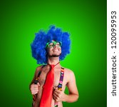 Funny guy naked with blue wig and red tie on grey backgrund - stock photo