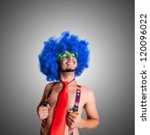 Funny guy naked with blue wig and red tie on green backgrund - stock photo