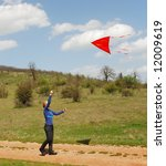 a woman is playing with a kite | Shutterstock . vector #12009619