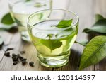 glass cup with fresh green tea - stock photo