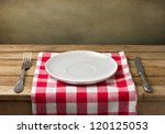 empty plate on wooden table... | Shutterstock . vector #120125053
