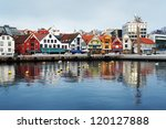 STAVANGER, NORWAY - MARCH 6: Guest harbour with old-style houses on March 6, 2011 in Stavanger, Norway. Stavanger is Norway's fourth largest city, and is called the petroleum Capital of Norway. - stock photo