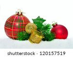 Close up of decorative Christmas ornaments on the snow. - stock photo