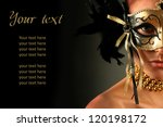beautiful woman in mysterious mask - stock photo