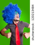 funny dancing guy with blue wig green eyeglasses and red tie on grey background - stock photo