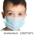 5 years old boy in medicine healthcare mask isolated on white background - stock photo