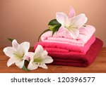 stack of towels with pink lily... | Shutterstock . vector #120396577