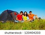 three teenagers sit beside tent   Shutterstock . vector #120404203