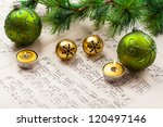 Christmas carol with jingle bells and candles - stock photo