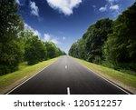 asphalt road in green forest.... | Shutterstock . vector #120512257