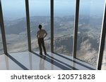 man looks at the mountain from a height - stock photo