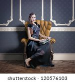 beautiful woman in luxury armchair - stock photo