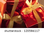 Two Red Christmas Gifts With...