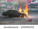 SAINT-PETERSBURG, RUSSIA-NOVEMBER 11: Burning car is on city street with used extinguishers on November 11, 2012 in Saint-Petersburg, Russia. Self-ignition car wiring. No one was injured. - stock photo