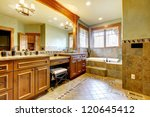 Luxury large master bathroom in mountain home with double sink and green walls. - stock photo