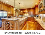 Mountain luxury home with wood kitchen and granite countertop. - stock photo