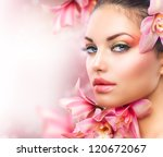 Stock photo beautiful girl with orchid flowers beauty model woman face perfect skin professional make up 120672067