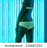 beautiful girl closeup in swimsuit at solarium - stock photo
