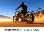 Against the landscape of the motorcyclist. - stock photo