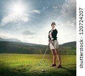 Young Woman Playing Golf On A...