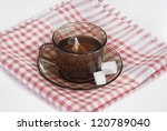 and two slices of sugar on a checkered napkin - stock photo