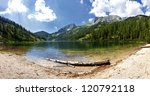 Mountain lake - Austria The Steirersee (1.447m) is a mountain lake of Tauplitzalm/austria and surrounded by natural forest. The mountain range on the right is part of the Toten Gebirge. - stock photo