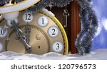 Happy New Year and Merry Christmas background with old clock,decorations, key and snow - stock photo