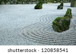 Zen Garden on Dark day with moss covered rocks - stock photo