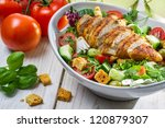 Close-up on a salad with chicken and tomato - stock photo
