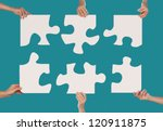 Woman hands holding puzzles together concept - stock photo