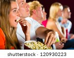 young people watching movie at movie theater - stock photo