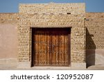 Old Public building - traditional mud building  near Dubai, Sharjah, Abu Dhabi in United Arab Emirates.beautiful arhitecture of arabic culture - stock photo
