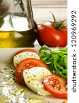 Caprese salad, italian appetizer with mozzarella and tomatoes - stock photo