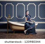 woman , sitting on the vintage bathtub - stock photo