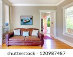 Leather sofa and living room with open door with grey walls. - stock photo