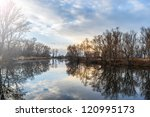 reflection on a peaceful pond... | Shutterstock . vector #120995173