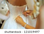 bridesmaid tying bow on wedding ... | Shutterstock . vector #121019497