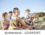 group of young people having a good time outdoors - stock photo