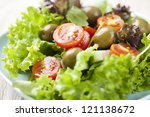 fresh salad with tomatos, olives, lettuce and cucumber - stock photo