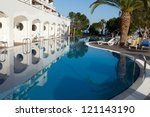 Swimming pool at the modern luxury hotel - stock photo