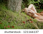 low view of a beautiful blonde... | Shutterstock . vector #121166137