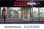 "EDINBURGH - OCTOBER 27: the exterior of a Tesco Express store on October 27, 2012 in Edinburgh, UK. On December 5, 2012, Tesco announced closure of up to 200 stores in the US branded ""Fresh & Easy"". - stock photo"