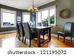Large green dining room with leather chairs and large windows. - stock photo
